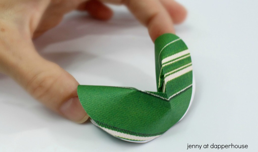 fold the paper in half to make a fortune cookie note - jenny at dapperhouse