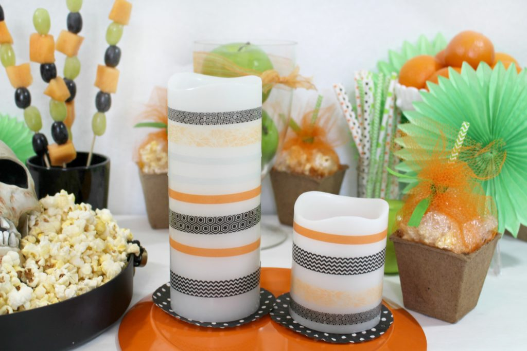 learn how to make these washi tape halloween candles and throw a healthy Halloween party with jenny at dapperhouse blog
